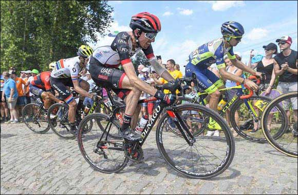 Martin Survives a Brutal Day of Racing on the Cobbles of Stage Nine