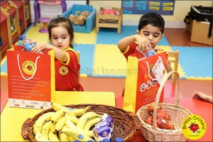 Nursery children gift Eid packages to labourers