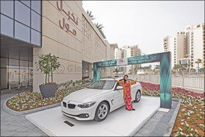 Filipina mum of three bags brand new BMW in Nakheel Mall's DSF promotion