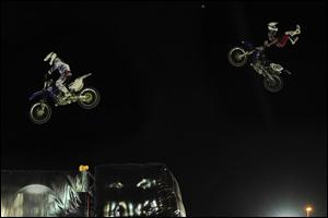 Freestyle Motocross Daredevils Performing Hair Raising Stunts at Global Village